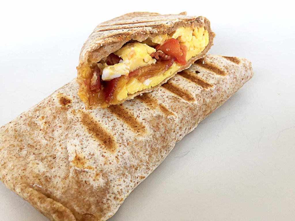Bacon Cheddar Breakfast Wrap at West Village Cafe